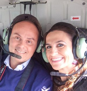 Monique Soltani on a helicopter ride with Ferrari Winery CEO Matteo Lunelli.